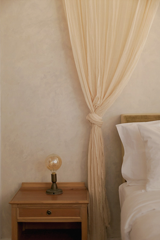 Curtain drape by bed in Artist Atelier hotel suite