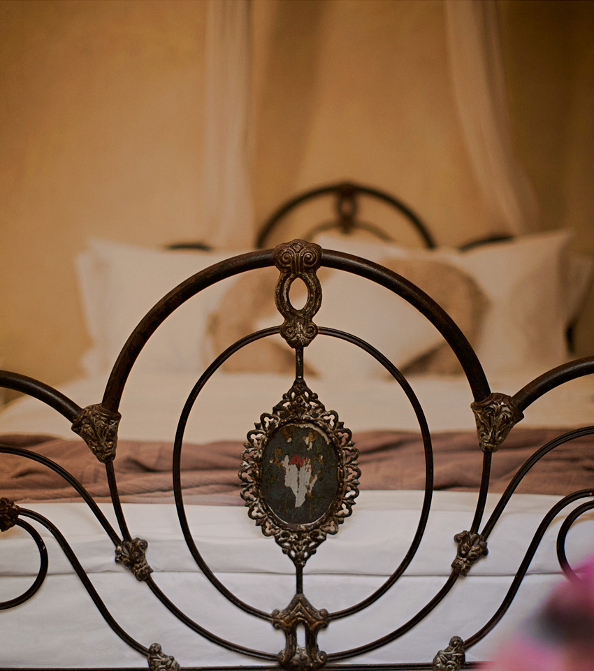 Detail of wrought iron bed frame in hotel suite