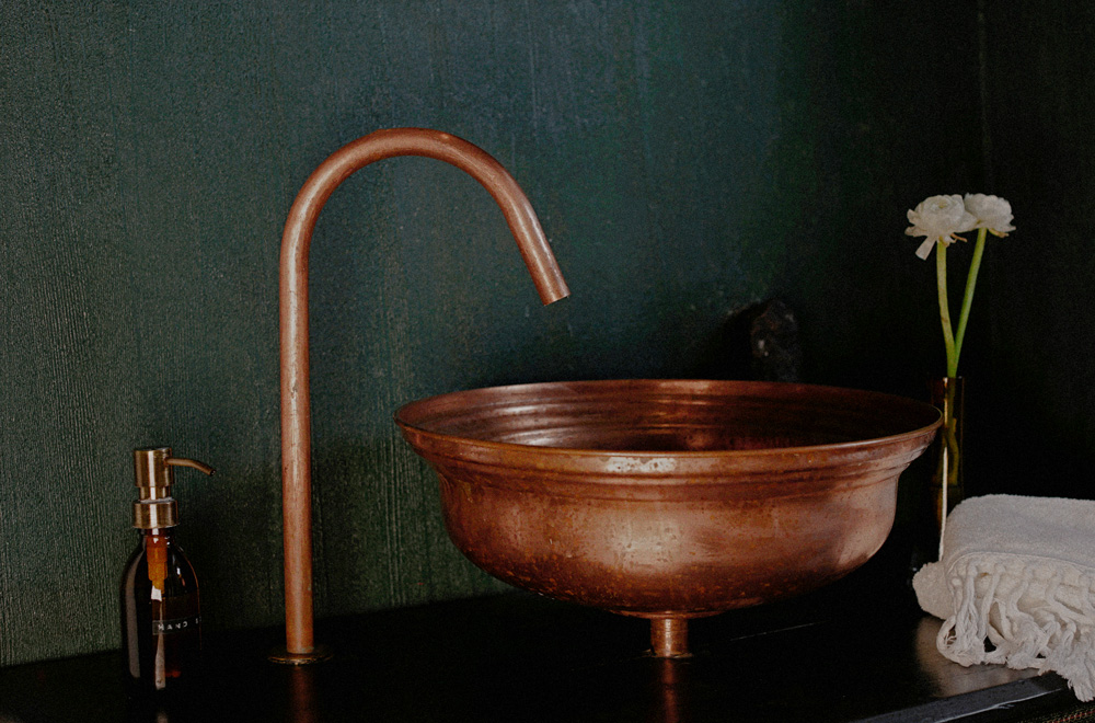 Bronze sink and tap in Romantic Dust hotel suite
