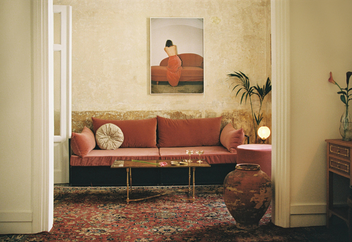 Pink velvet sofa in lounge of Artist Atelier hotel suite