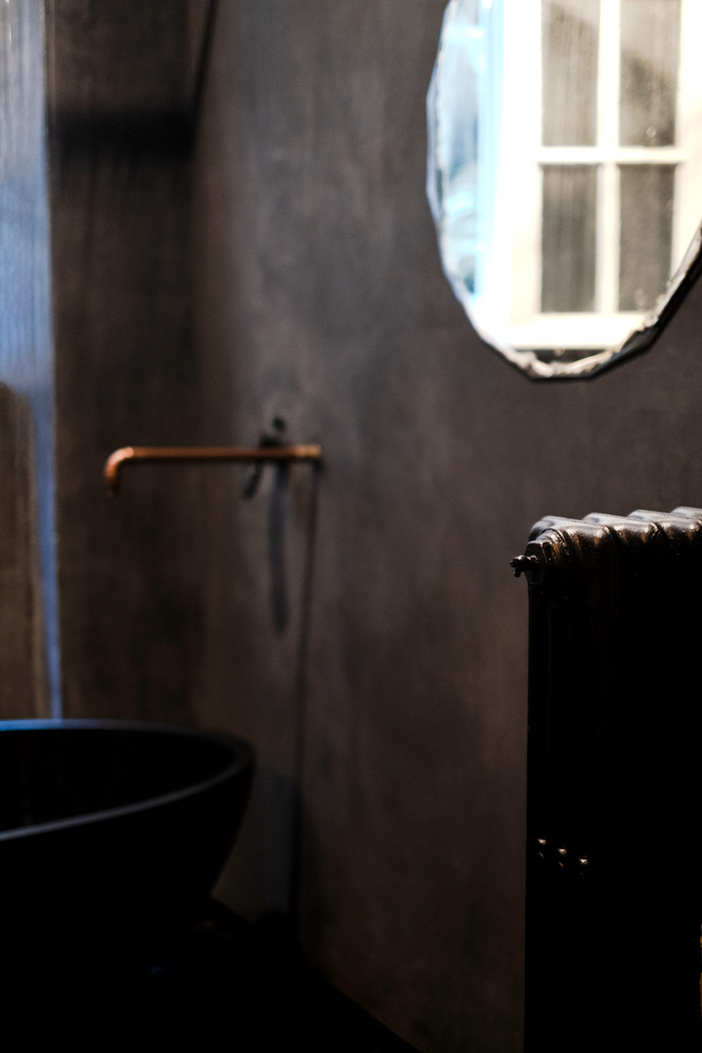Grey bathroom in romantic dust hotel suite