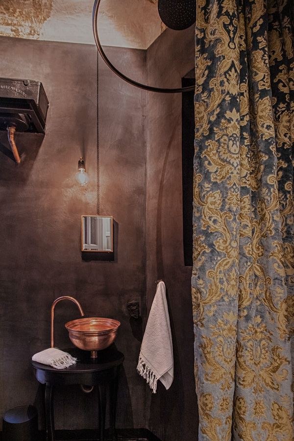 Velvet shower curtain and grey walls in bathroom