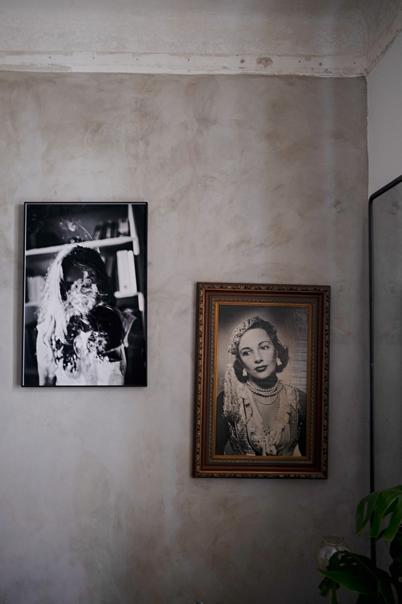 Old photographs on wall in hotel suite